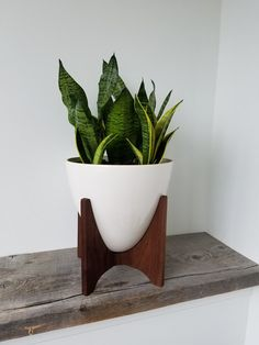 Mid Century style with a Danish influence best describes our Vaughn Planter design. The vessel is made from cone 6 porcelain and…