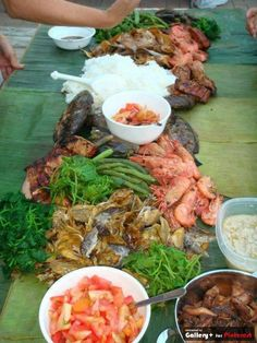 Traditional Filipino Food served the traditional way, on banana leaves.