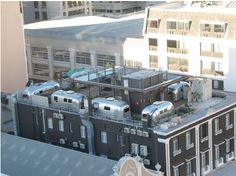 Grand Daddy Hotel in Cape Town, South Africa is certainly making it's mark on the hotel industry. This swanky yet playful hotel has put a new twist on the old trailer park. The Daddy is famous for it'sAirstreamRooftop Trailer Park. It's seriously amazing.