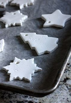 Clay recipe: 1/2 cup cornstarch + 1 cup baking soda + 3/4 cup water. Bake at 175. I made some decorations a couple of years ago using this recipe. They are still beautifully white and crisp.