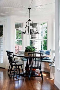 bay window seating bench and chairs