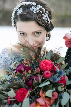 winter wedding by JOIN, blue wedding dress by Solaine Piccoli Vienna and crystal flower crown by Niely Hoetsch Atelier Vienna. Winter bridal bouquet with feathers, roses in bordeaux, blue by Blumen Brandstaetter, Fuschl am See. Vienna Winter, Winter Bridal Bouquets, Blue Wedding Dresses, Crystal Flower, Elegant, Flower Crown, Bordeaux, Feathers, Join