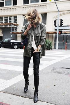 Anine Bing exudes tomboy vibes in a khaki jacket and studded boots.Outfit: Anine Bing (Brand).