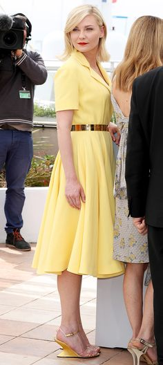 KIRSTEN DUNST at Cannes 2016 wears a lemon-meringue Dior Haute Couture shirtdress with a gold belt and perfectly matched sculptural Salvatore Ferragamo wedges with a very French Riviera-red lip to the Cannes jury photocall. French Film Festival, Cannes Film Festival, Dior Haute Couture, Kirsten Dunst, Glamour, Fashion Gallery, Red Carpet Looks, Red Carpet Dresses, Mellow Yellow