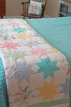 Vintage bedroom and old star quilt and chenille spread in pastels