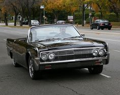 1961 Lincoln Continental Convertible.  It has everything, classic American style, Presidential history, and suicide doors for the back seat. andrew_t_wood