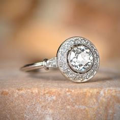 A beautiful diamond halo engagement ring, adorned with an old European cut diamond.