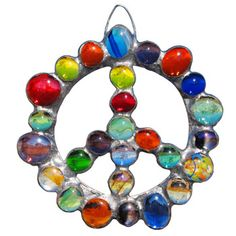 peace sign garden ornament at gardenart.com    i have hanging in a window love it