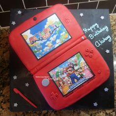 Nintendo 3DS XL cake with an edible Super Mario game print by me :)