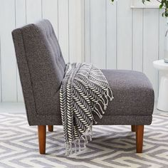Chair to go with sofa http://www.westelm.com/products/rounded-retro-armless-chair-h767/?pkey=e%7Carmless%7C18%7Cbest%7C0%7Cviewall%7C24%7C%7C2&cm_src=PRODUCTSEARCH