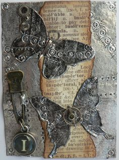 Loved the industrial faux riveted metal look that Tim Holtz shows how to create on his blog in the Sept 12 Tags of 2012 post.  Check it out...