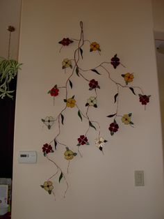 This vine is made from scrap glass and recycled wire.  I really love this!!!!!  Use could make it with butterflies or hearts.