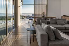 Strong geometry, clean lines and contemporary finishes help GSquared Architects redefine the traditional beach house vernacular with this home in Melkbos on Cape Town's West Coast. Home, Outdoor Sectional Sofa, Timber Staircase, Interior, Modern Light Fittings, Spacious, Modern, Timber Screens, Home And Family