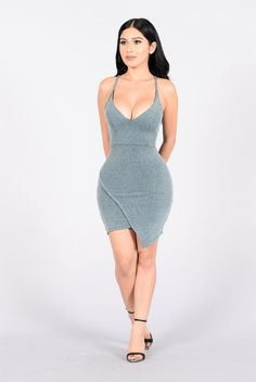 - Available in Blue - Midi Length Dress - Spaghetti Straps - Asymmetrical Hem - Made in USA - 77% Polyester 18% Lurex Metallic 5% Spandex
