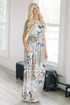 This is one of the most beautiful maxi dresses we have seen! Our Pretty as a Petal Maxi dress is a beautiful light stone and features short sleeves, an elastic waist, cute pockets and a lovely dusty blue and white floral print.