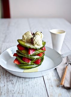 Have a special occasion coming up? This is a recipe that works perfectly as a dessert or even as a fancy brunch treat. | Matcha Pancakes With Hot Chocolate Ganache & Strawberries