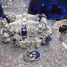 """This detailed sterling silver dangle features a stunning night sky motif and the sweet engraving """"I love you to the moon and back"""". It is the ideal jewelry piece for showing someone special that your love is as endless as the universe. #TheJoyOfGiving #MyPANDORAGift #PANDORA #PANDORACharm #PANDORABracelet #PANDORAjewelry #PANDORAPTC #TheLookOfYou #PickeringTownCentre #PTC #inTown #PickeringOntario @pickeringtowncentre"""