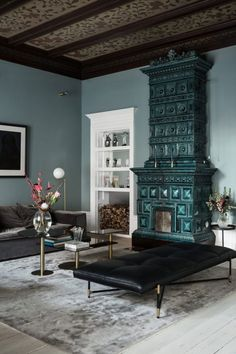 light blue walls with teal fireplace. / sfgirlbybay