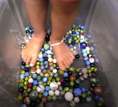 marble massage bin for the teeny tootsies of the kiddos who need that sensory input