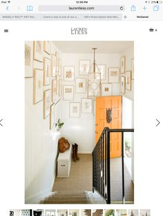 Gallery wall wrapped around inside of stairs!