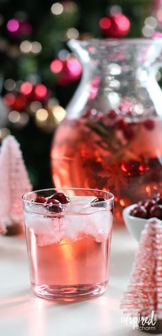 Jingle Juice Holiday Punch - you only need a few minutes and three ingredients to whip up this delicious punch. You guests will be begging for the recipe. inspiredbycharm.com
