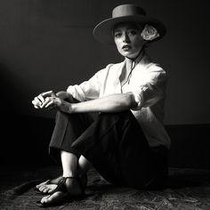 Caroline Vreeland shot by Michael Avedon. Wearing Brixton hat, Equipment blouse, Ferragamo trousers, Casadei sandals.