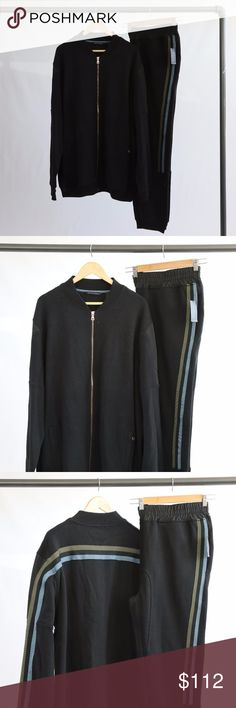 """Sean John Black Sweatsuit Sean John Black zip up sweatsuit with green and blue stripe across back and arms. Zip up front pockets and paneling detail on sleeves. Pants have drawstring elastic wiast and blue and green stripe that go down the leg. Button closure back pockets. Approx. 31.5"""" on the the pants. Sean John Other"""