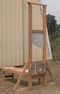 """I like this guy's plans on building a guillotine. Here is his info: I finally found my old photos of the one I built back in 2002. I thought I would share some of the build photos and the any insight I gained during the process. I have no exact dimensions for this project. But the photos should explain it pretty well. This first pic is of the completed guillotine. It stands about 9' tall. The bench behind it where you put the """"victim"""" is about 6' long and about 2"""