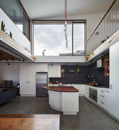 Central void of the house with kitchen and an angular island