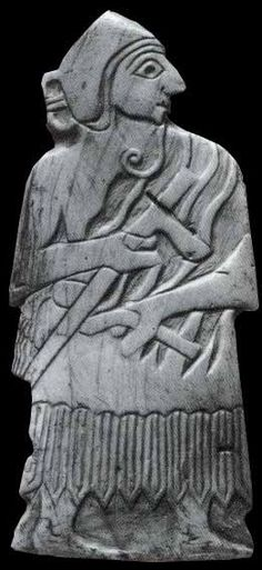 Shell plaque of a Sumerian soldier with a battleaxe. This plaque, in the Louvre, is from the city of Mari, and is dated 2500 B.C., the same time period as the Royal Tombs of Ur