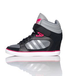 adidas Mid top womens wedge sneaker Lace up closure with velcro strap Signature triple adidas stripes on sides Wedge heel Cushioned inner sole for comfort