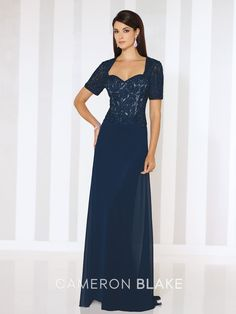 Short sleeve chiffon A-line gown with Queen Anne neckline, ribbon work and hand-beaded bodice with tonal lining, sweep train. Sizes: 4 – 20, 16W – 26W Colors: Burgundy, Navy Blue, Black