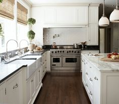 Traditional style kitchen coupled with commercial equipment. Subway tile, some stainless steel counters for practicality, quartz or recycled glass counters, and a lower level marble counter for the baking station.