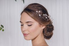"Coralie<a class=""cap-link"" href=""http://www.debbiecarlisle.com/collections/wild-rose-collection-1/products/mother-of-pearl-flower-cluster-wedding-hairpins-coralie"" target=""_blank"">Click to see on the Debbie Carlisle website</a>"