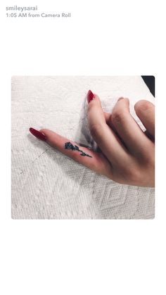Rose Finger Tattoo
