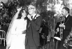 Jimmy Stewart singing with his daughter, Judy, at her wedding. 1977