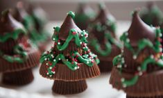 Chocolate Candy Christmas Trees ~ Stack 2 Reese's Peanut Butter Cups with 1 Regular Reese's Peanut Butter Cup and top with 1 Hershey Kiss. Then decorate with sprinkles and icing.