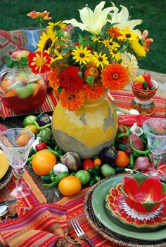 Bright and cheerful mismatched tablescape. Great Cinco de mayo or Mexican party theme flower and decor.