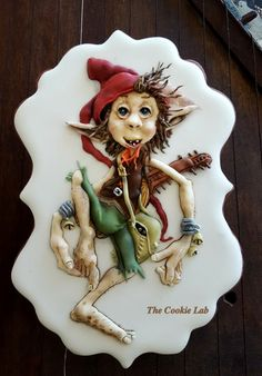 The Cookie Lab by Marta Torres Coloured Royal icing decorated cookie - Not Painted #gnome #sugarcookies #royalicingcookie #royalicing #sugardecoratedcookie #cookielovers #royalicingart #royalicingartist #martatorrescookies #thecookielab