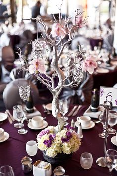 Love this tree branch with flowers and hanging candle votives. Love what they did with the base! I want to make something like this for the escort card table and possibly at the guestbook table at the ceremony