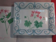 hand painted porcelain tray with geranium pink flower, and sky blue border