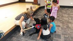 https://flic.kr/p/xDup12 | Animal Heroes Part 2 - July 22, 2015 | Visiting therapy dog, Bailey, helps kids learn how to interact when first introduced to a dog.  July 22, 2015.
