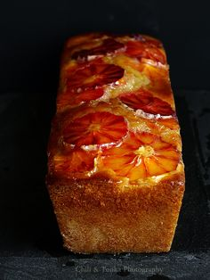 Yogurt Cake with Blood Oranges. This is just beautiful.  1.5 cups of flour,  2 teaspoons baking powder,  3/4 teaspoon salt,  1 cup of sugar,   1 tablespoon grated lemon or orange peel,   3/4 cup Greek yogurt,   1/2 cup vegetable oil + a little to grease the mold,   2 large eggs,   1/2 teaspoon vanilla extract,   Two red oranges, and   one tablespoon orange blossom water.