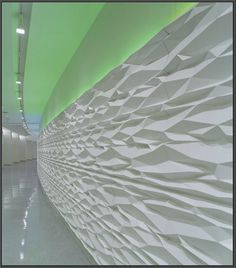 Using Computer Aided Design and Manufacturing, Plasterform created origami-like GRG wall panels  http://www.plasterform.com/index.php#/projects/project/us-census-bureau
