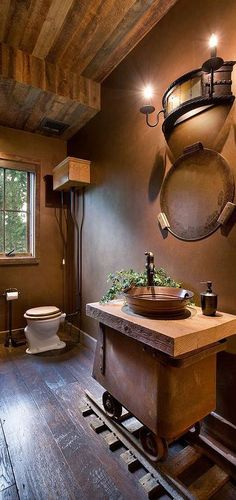 21 Ways to Achieve the Rustic Look in Any Part of Your Home… #9 A Vanity Basin on a Dedicated Railway Line