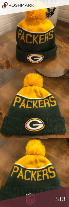 """Green Bay Packers Sideline Beanie Stocking Cap Great condition Green Bay beanie! Youth Size Team: Green Bay Packers Brand: New Era Style: 2015 On Field Sideline Sport Knit Material: Shell: 100% acrylic; Lining: 90% polyester, 10% wool Color: Green, with a white stripe, and a yellow top and pom Front Stitching: """"G"""" logo Back Stitching: """"NFL"""" Shield logo Side Stitching: New Era logo Cap Design: Cuff and pom with """"PACKERS"""" knitted on front and back Size: One size fits most NFL Accessories Hats"""