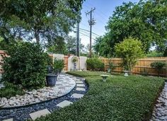 A lawn you don't have to worry about watering - gravel and ground cover require little or no water to maintain
