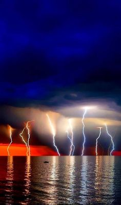 Lightning strikes are often related with solid objects like trees and tall buildings, but they can also hit bodies of water. Lightning over. Beautiful Sky, Beautiful World, Wild Weather, Lightning Strikes, Lightning Storms, Natural Phenomena, Science And Nature, Nature Nature, Wild Nature