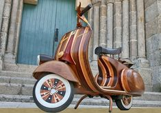 Craftsman Carlos Alberto came across a Vespa that was in complete disrepair, so he gutted it and carved a body from wood—which he then coated in a multitude of beautiful steam-molded veneers.