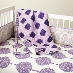 @Jessica Ubl I love this sheet too but not the throw quilt LOL    The Land of Nod   Baby Crib Bedding: Baby Purple Patterened Crib Bedding Set in Crib Bedding
